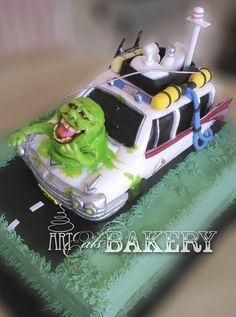 3D specialty groom's cake featuring the delectable Ecto–1 GhostBuster's car with Slimer leading the way