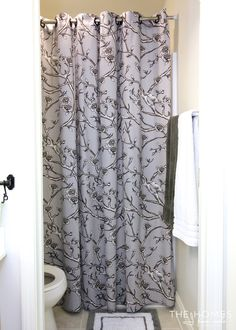 hang extra long curtains as a shower curtain