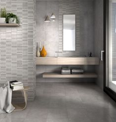 The latest international trends show cement-look tiles paired with wood furniture, adding an element of nature to the industrial trend. Play with different tiles sizes and formats to add interest, then finish the look off with a pop of colour in your accessories. #trendingdesign #dreamhome #cementlook #industrial #home #tiles #woodlook #homegoals