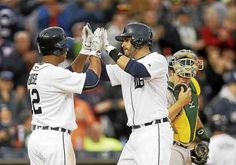 Detroit Tigers' J.D. Martinez, right, is congratulated by Anthony Gose (12) after they and Ian Kinsler scored on Martinez's three-run home run during the second inning of a baseball game against the Oakland Athletics, Wednesday, April 27, 2016, in Detroit. (AP Photo/Carlos Osorio)