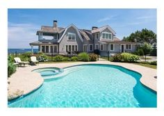 A beautiful home and pool with waterfront views. $4,500,000 Scituate, MA Listed by Coldwell Banker Residential Brokerage.