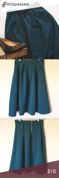 """Forever 21 Full Skirt Adorable a-line, full skirt with geometrical shapes throughout. Gorgeous deep teal. Zipper closure. Excellent condition. Size Small  Measurements: 14"""" waist and 25"""" length.  *NO TRADES*                                                             ⭐️Use the """"Buy Now"""" or """"Add to Bundle"""" button for Purchasing. 10% off bundling available. ⭐️ Forever 21 Skirts A-Line or Full"""