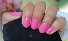 Essie pink polish. This is super feminine with short, round nails.