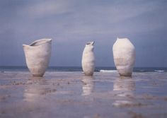 Tony Lattimer - ceramic sculpture  -  'Pregnant Silence' on the beach   	largest 113cm X 57cm   	photo Steve Tanner
