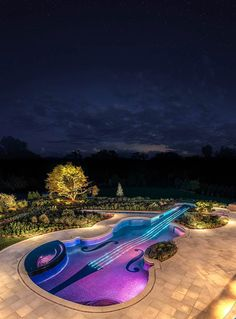 When a client came to the New Jersey pool company Cipriano Landscape Design  Custom Pools asking for a pool in the shape of a violin, the request was met with some surprise. Nevertheless, with fiber-optic rope lighting installed to shine lights resembling violin strings and a koi pond built to act as the violin's bow, the violin pool was born.