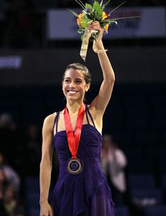 Alissa Czisny waves on the awards podium after receiving her gold medal at 2011 Skate America.
