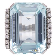 Large Emerald Cut Aquamarine and Diamond Ring | From a unique collection of vintage cocktail rings at https://www.1stdibs.com/jewelry/rings/cocktail-rings/
