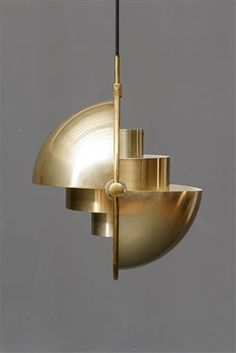 Louis Weisdorff. Multi-lite pendant, brass, adjustable shades. Produced by Lyfa. 1960's. Ø 30 cm. Lighter signs of wear, scratches. Designed in 1931 for Radio House, Copenhagen. Produced by Louis Poulsen.