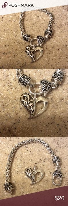 """Chain Bracelet & Removable Heart Charm Soooo pretty! Nice weight! This is a cute Brighton """"look alike"""".  Heart is removable and can be worn on the right kind of chain (see photo 7).  Fits a small wrist. Measures app. 7.5 inches, but fits 7-7.25 wrist. Lobster claw clasp. Not heavy, but a good weight, not a cheap lightweight piece. Perfect condition. Smoke/pet free environment. NA Jewelry Bracelets"""