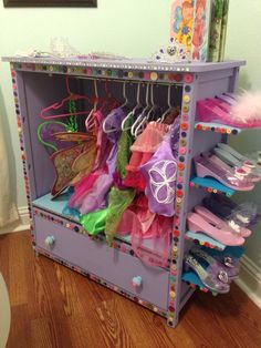 Entertainment center dress up dress up closet, dress up wardrobe, tod Dress Up Wardrobe, Dress Up Closet, Repurposed Furniture, Kids Furniture, Dress Up Stations, Dress Up Storage, Princess Room, Toy Rooms, Little Girl Rooms