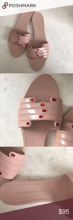 Charlotte Olympia Mani Slide Sandals Rubber sandals. Perfect for the spring or summer. A muted pink or blush color with two hands that meet to make the strap. Include bejeweled stones. Some use and wear to bottom of soles but in great condition! As worn by Gigi Hadid! Size L Charlotte Olympia Shoes