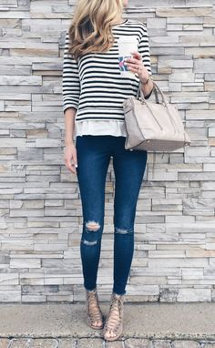 spring outfit idea: striped ruffle hem top with skinny jeans and lace up booties
