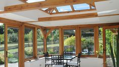 oak orangery table and chairs room extensions flat roof Contemporary Oak Orangery, Somerset