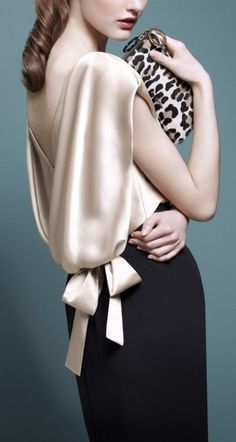 So feminine, so elegant. Black pencil skirt, champagne satin blouse with cowled back and leopard print clutch