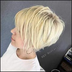 Finely Chopped Buttery Blonde Pixie The long pixie hair cut is almost a bob with volume on top and thinned out ends. The wispy feel of finely chopped strands is played up by the subtle buttery blonde balayage added to the platinum blonde base. Long Pixie Hairstyles, Thin Hair Haircuts, Hairstyles Haircuts, Hairstyle Short, Short Haircuts, Layered Hairstyles, Blonde Hairstyles, Braid Hairstyles, Edgy Pixie Cuts