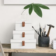 Don't toss out those shoeboxes, use them to make attractive storage boxes for your home office or craft room.