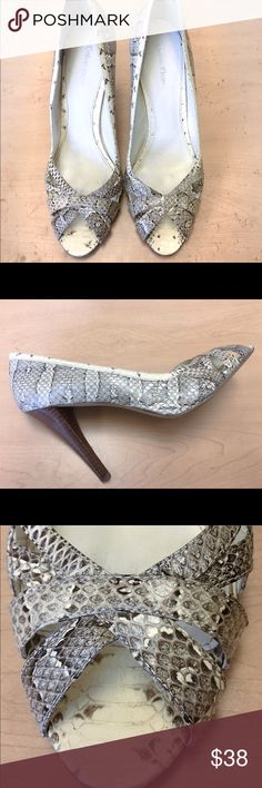 Calvin Snakeskin d'orsay pumps size 7 Gorgeous faux snake-skin pumps from Calvin Klein.  They are beautiful on and goes with everything.  Worn twice.  Someone my foot shrunk.  Can't explain that but it's someone else's gain.  Enjoy! Calvin Klein Shoes Heels