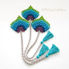 This crochet bookmark in the form of a peacock feather would make for a lovely and original birthday, teacher or Christmas gift.The crochet peacock fan feather bookmark is my own original design and I have made it using mercerized cotton and a mm Crochet Bookmark Pattern, Crochet Bookmarks, Crochet Motifs, Crochet Books, Basic Crochet Stitches, Knit Crochet, Blanket Crochet, Ravelry Crochet, Crochet Keychain