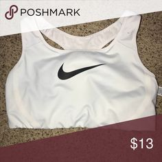 b4a7c7fc576fca Nike medium support sports bra White nike sports bra, worn only once . Band  inside the bra. Lightly padded, great for any workout ! Nike Other
