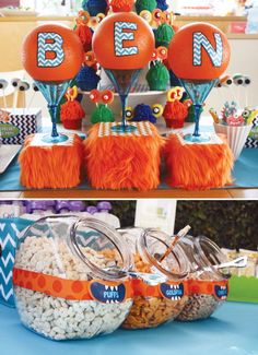 FUZZY Orange Monster Party for a first birthday with googly eye cake balls, a bright orange smash cake, make your own monster mask station..