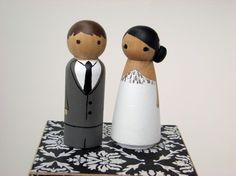 Peg People Wedding Toppers! You can find them on Etsy pre-painted or unpainted.  I bought unpainted to add my own personalization. My peg couple will be posted soon!