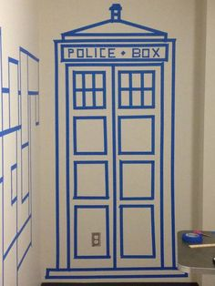 Painters tape TARDIS - this is a brilliant idea for decorating dorm walls! BRB, got to go to Home Depot and pick me up some painters tape. The Tardis, Tardis Door, Dorm Room Doors, Dorm Walls, Attic Renovation, Attic Remodel, Dr Who, Doctor Who Party, Painters Tape