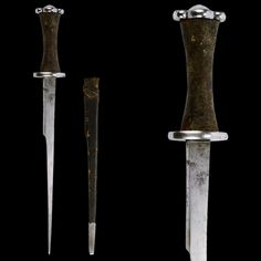 "A German Rondel Dagger with its Original Sheath, early 15th century  Overall length: 52 cm (20.47""); Blade length: 36.6 cm (14.4"")  Located at Reichsstadtmuseum Rothenburg, Germany"