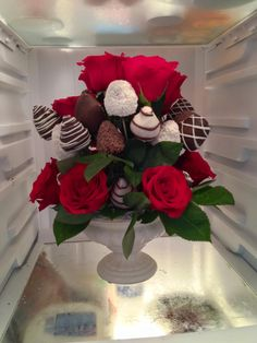 Edible arrangement with red toes and chocolate covered strawberries.