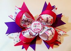 """4.5 Inch Boutique Hair Bow Spiked Pinwheel Flat Back """"I don't do BOWS off the Rack"""" Embellishment and Ribbon Coordinating Grosgrain Ribbon in Purple and Fushia This adorable bow with attitude is compa"""