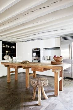 Rustic table adds warmth and depth to a modern kitchen