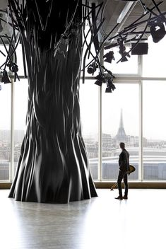 Electric by Mathieu Lehanneur. Lighting projectors and cables hang from the spindly branches of chunky black trees inside this penthouse bar and nightclub in Paris by French designer Mathieu Lehanneur Tree Interior, Interior And Exterior, Interior Decorating, Interior Ideas, Mathieu Lehanneur, Plastic Art, Black Tree, To Infinity And Beyond, Paris Photos