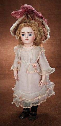 At Play in a Field of Dolls (Part 1 of 2-Vol set):                       159  French Bisque Bebe by Leon Casimir Bru in Rose Silk Costume and Signed Bru Shoes