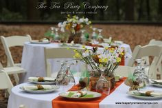 nothing like a party in the woods!!!! Polyester  and Satin Linens Flower Centerpieces China Glassware Silverware All for rent @ The Tea Party Company!