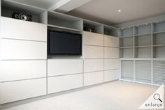 Wall storage unit. Good idea that tv can be mounted in centre if needed. Don't like open shelves at top & would like a longer cupboard shape storage as well as the smaller ones
