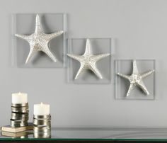 Create a sea life art gallery wall, beginning with this Silver Starfish Wall Art!  Silver starfish mounted on clear panels