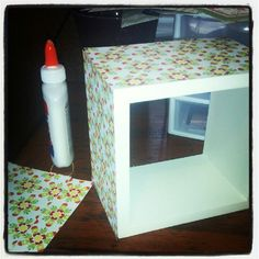 scrap book paper on cube shelves for cute decoration