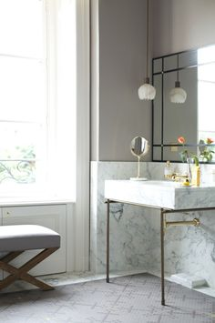 Look We Love: White Marble in the Bathroom www.apartmenttherapy.com Image: Lonny