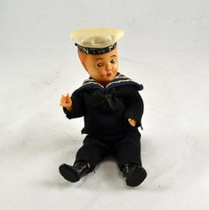 1930s celluloid Sailor doll with hat that says Santa Maria. An old 1920s 30s cruise ship souvenir. Very RARE! 7 Tall. Sleep type eyes. In great condition with the exception of little brown spots on the top of his Sailor hat. Possible this is a Nora Wells Doll. Check out more dolls in the Doll section here: https://www.etsy.com/shop/ChicMouseVintage?ref=hdr_shop_menu Please see all 5 pictures as they are part of the description. Visit my Shop Home for more fun finds!:...