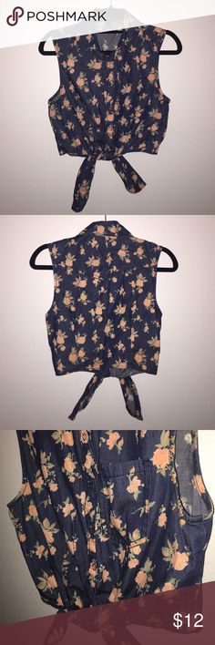 Forever 21 Front-tie Denim Floral Top This is a super cute collared tank with a front-tie. The material is a faux navy denim with a pink/coral floral pattern. It has a snap button-down front and a small pocket on one side. Used lightly but still in perfect condition! Pair with your favorite high waisted shorts or skirt for a perfect summer outfit  Forever 21 Tops Button Down Shirts
