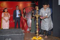 Mr.Akhil.S.Paul, Founder Director, Sense International(India) lights the lamp — with Yogesh Aggarwal, Sudha Subramanian Aggarwal and Neelam Sharma at Y.B. Chavan Auditorium.