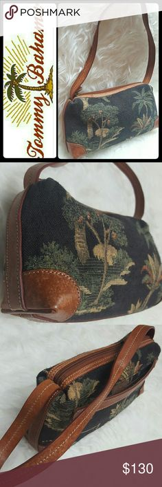 Tommy Bahama Canvas Leather Purse Tommy Bahama Designer Brand in Adorable Canvas Print with Rich Leather Trim and Handle! Iconic Brand Purveyor of Island Lifestyle! A Great Keeper Your Essentials!  Top Zipper Closure Opens to Fully Lined Interior with Zipped Pocket, Stitched Leather Plate of Tommy Bahama Logo! Approx Size 11x5x3 Inches, Handle Drop About 9 Inches, Excellent Used Condition! Tommy Bahama Bags