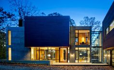 """Washington-based studio Robert Gurney Architect has designed the Wissioming2 Residence. This two story contemporary home is located in Glen Echo, a town in Montgomery County, Maryland, USA. Wissioming2 Residence by Robert Gurney Architect: """"Located in Glen Echo, Maryland, just outside of Washington, DC this new house is sited on a sloping, wooded lot with distant views of the Potomac River. The house is positioned to preserve a majority of mature trees and is oriented ..."""