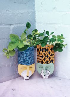 Want to get creative with flower pots? Here are 60 creative DIY planters that you can try as your next craft project. Plastic Milk Bottles, Plastic Bottle Planter, Plastic Bottle Crafts, Diy Bottle, Recycled Bottles, Recycled Crafts, Diy And Crafts, Shampoo Bottle Diy, Bottle Holders