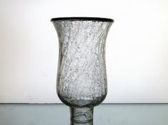 Crackle Glass Hurricane Shade 7.5 x 4 5/8 x 1 7/8 inch fitter Pewter Rim  Crackle glass replacement shade for your sconce, lamp or candle holder. Traditional flared design in hand blown and cut crackle glass, accented with a pewter rim. Eye catching shade, heavy and intricate. Bottom fitter edge measures 1 7/8 inches across and has a 1 inch neck. Flared top edge measures 4 5/8 inches across and stands 7.5 inches tall. Will add beauty to your wall sconce, candle holders or lamps.