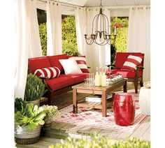 outdoor grommet drapes by Pottery Barn, have in sunroom and it really makes it elegant and doesn't take away from the view at all