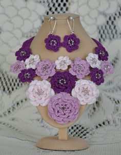 Beautiful hand crocheted jewellery earring and necklace set, using 100% fine cotton yarn and seed beads. Designed and made by me.