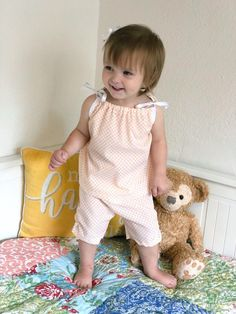 Our hopscotch tunic and short set is perfect for whatever your day has in store, from nap time to play time and everything in between. Knee length short has adorable ruching and bow detail. Tunic has adjustable ribbon ties for the perfect fit. Available in size 3/6 - 4/5T  Available in Creamsicle Check and Confetti ple