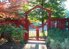 $  Salem Arch - The Salem Arch with a five foot opening and custom double moon gate with copper balusters, stained red.