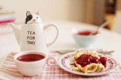 Pancakes with raspberry jam, tea.