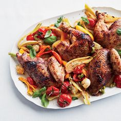 For this glorious chicken recipe, star chef Giada De Laurentiis stuffs red wine butter under the skin and roasts it on a bed of fennel, cherry tomatoes and peppers.